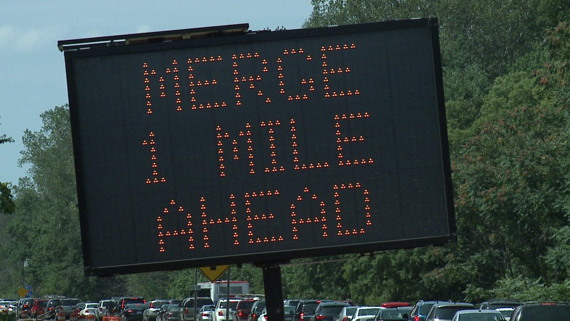 MDOT sign Merge One Mile Ahead